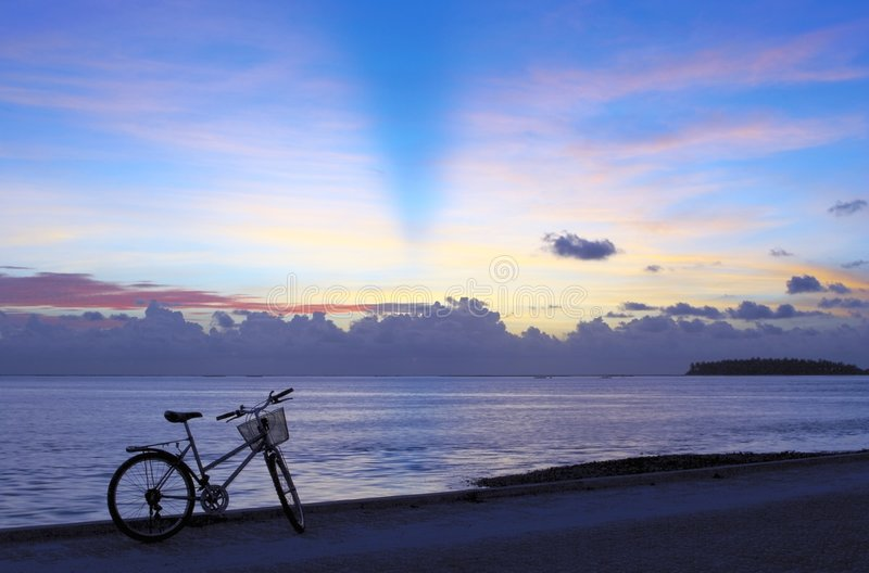 Pleasant bicycle walk. Along The Indian Ocean. Maldives stock photos