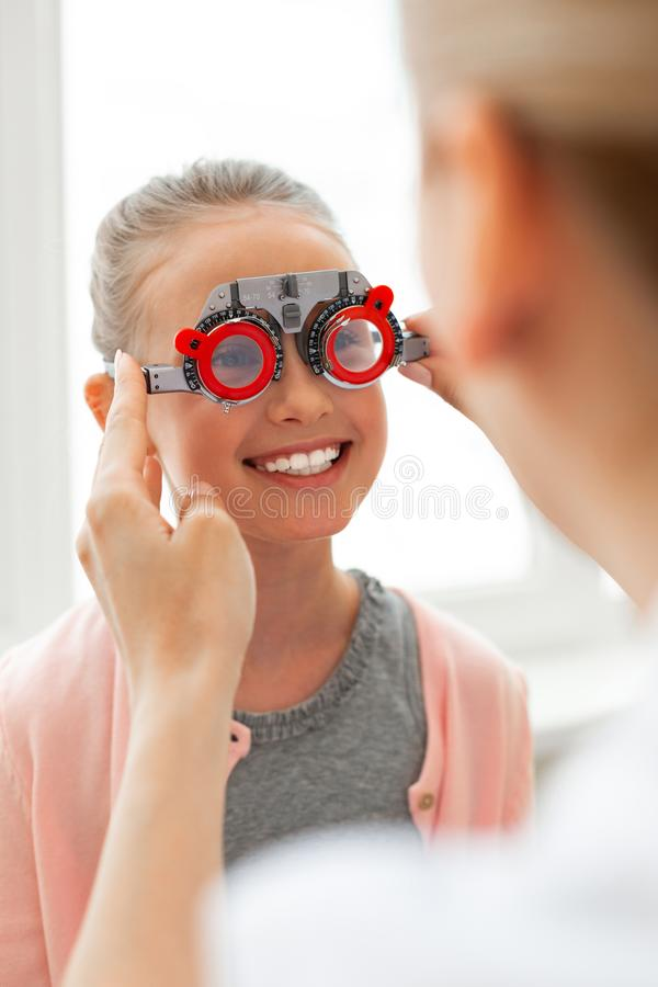 Pleasant bright child having fun during procedure with oculist stock photography