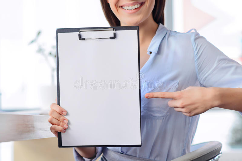 Pleasant business woman sitting at the table stock photos