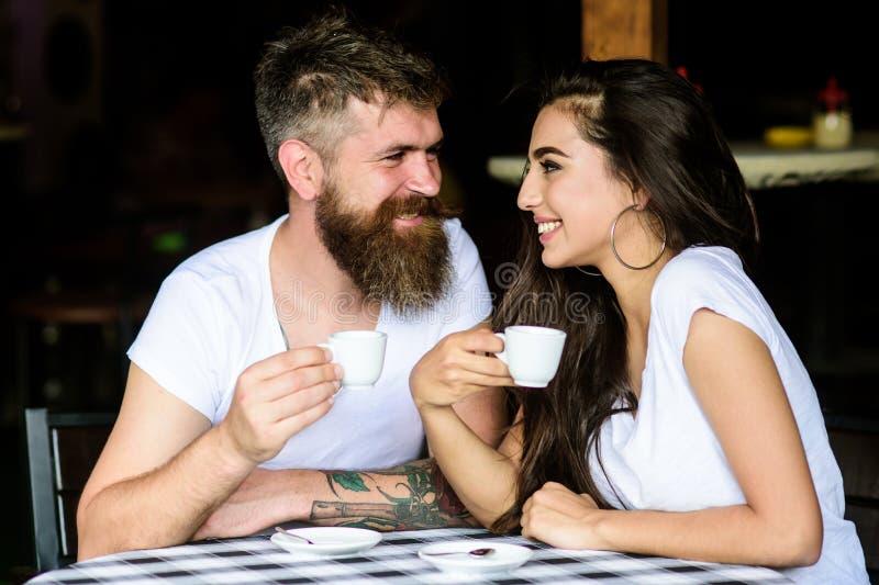 Pleasant coffee break. Couple in love drink black espresso coffee in cafe. Couple enjoy hot espresso. Drinking black stock photography