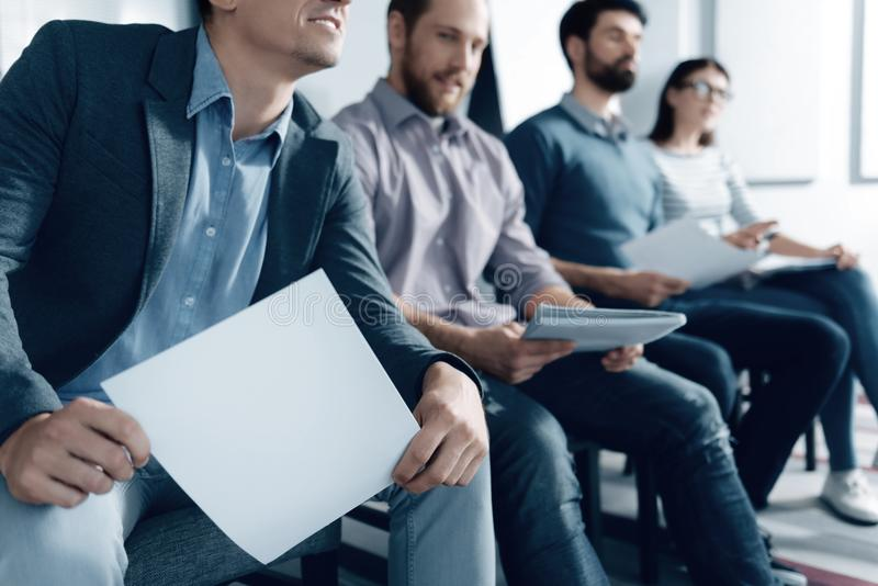 Pleasant colleagues sitting in one row stock image