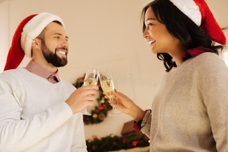 Pleasant couple making champagne toasts on New Years Eve stock photography