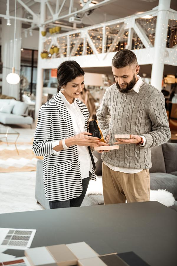 Pleasant cute couple being concentrated on shopping process stock images