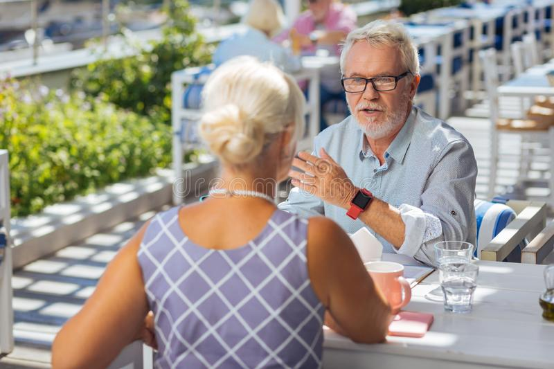 Smart elderly man speaking with his wife royalty free stock images