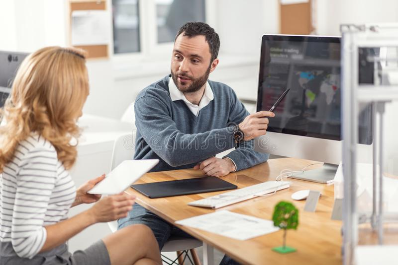 Pleasant man presenting his project to his boss stock photo