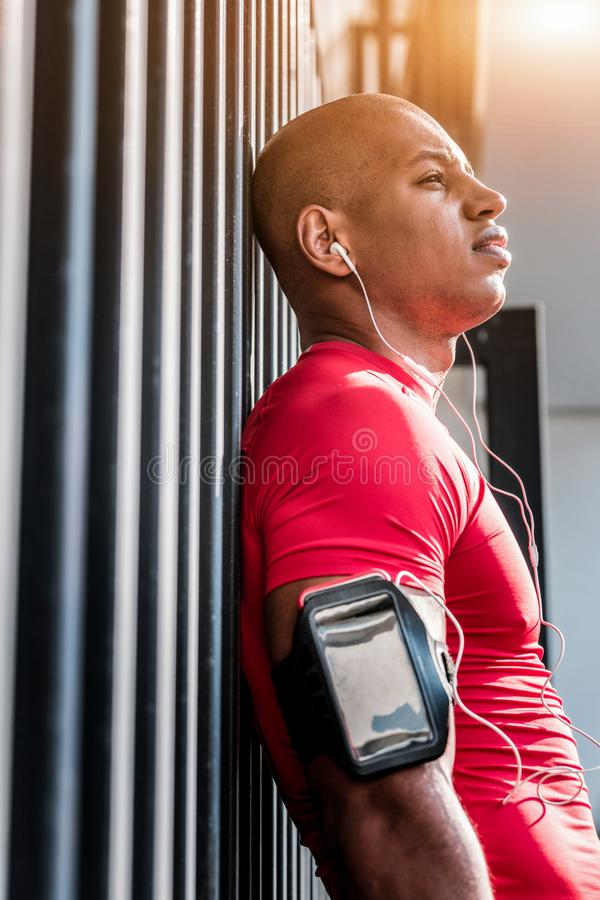 Pleasant nice man being satisfied with training stock image