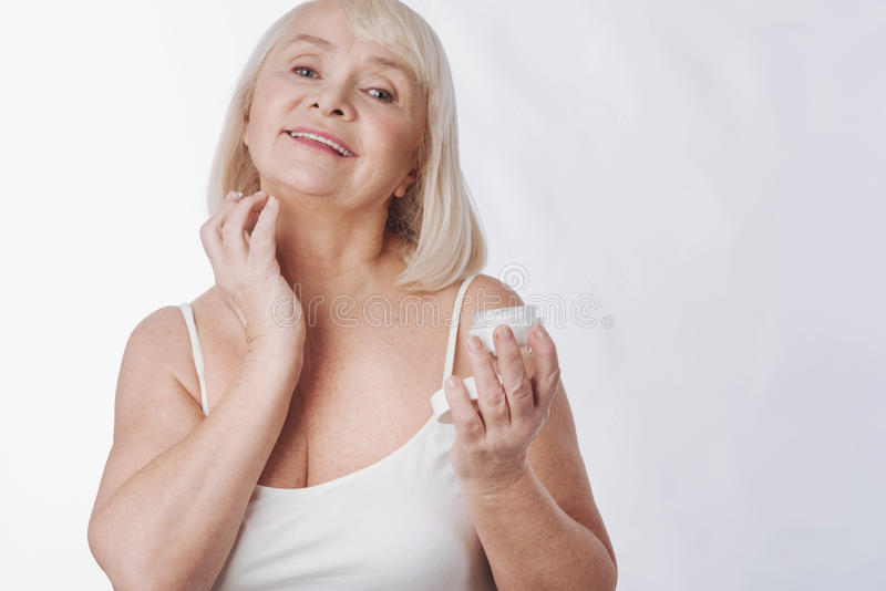 Pleasant nice woman fighting with age stock photography