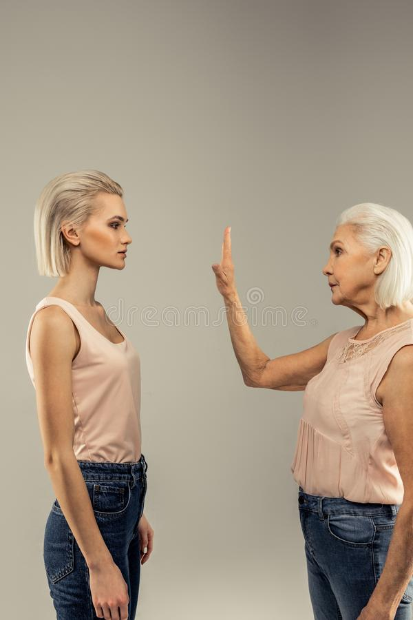 Pleasant nice women being divided by the barrier royalty free stock photo