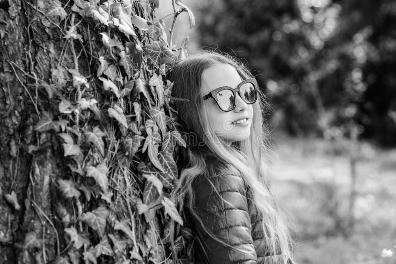 Pleasant relaxing walk in garden. Peaceful environment garden. Girl walk in botanical garden. Enjoying nature in garden. Kid cute fancy child spend time in royalty free stock photo