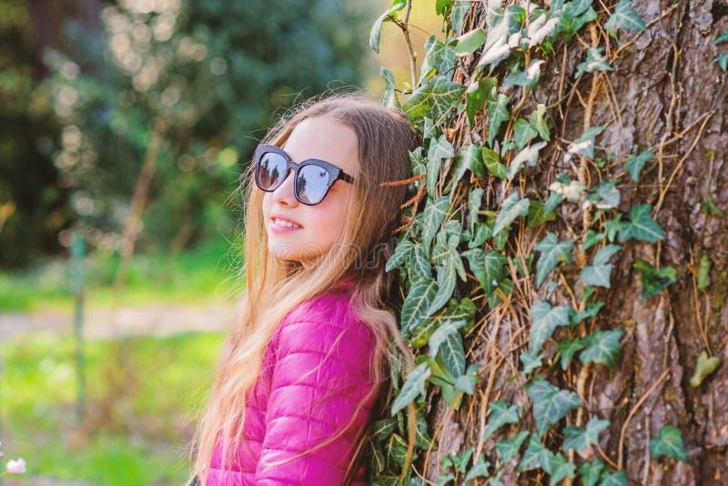 Pleasant relaxing walk in garden. Peaceful environment garden. Girl walk in botanical garden. Enjoying nature in garden. Kid cute fancy child spend time in stock image