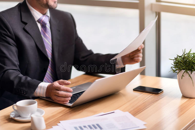 Pleasant senior man sitting at the table royalty free stock photos