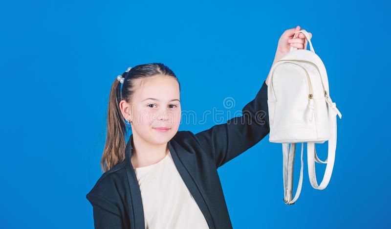 Pleasant shopping. Adorable girl with small bag. Small girl with shopping bag. Girl child enjoy shopping. Cute child. Holding bag on blue background. Little royalty free stock image