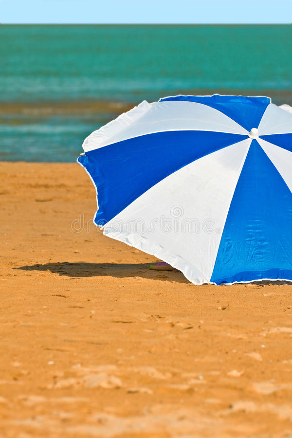 Pleasant Sitting Under A Colorful Umbrella On B Royalty Free Stock Photo