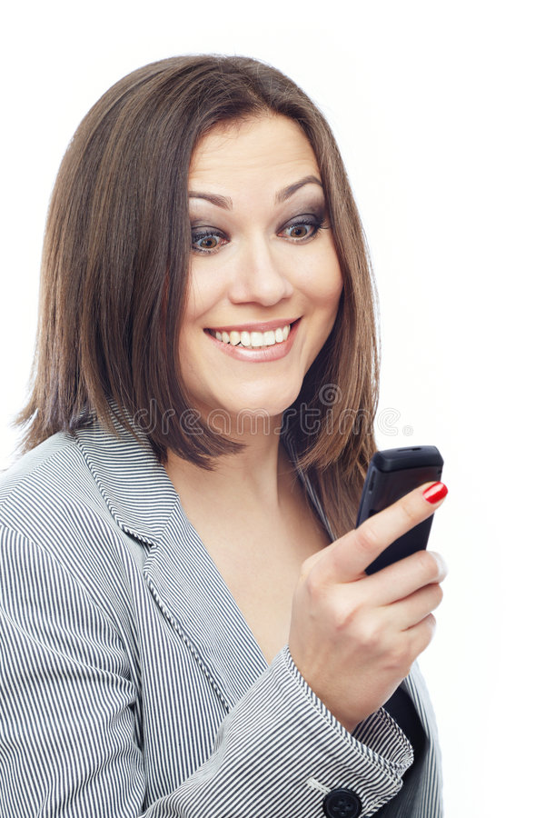 Pleasant SMS. Glad lady reading or sending SMS on a white background stock photos