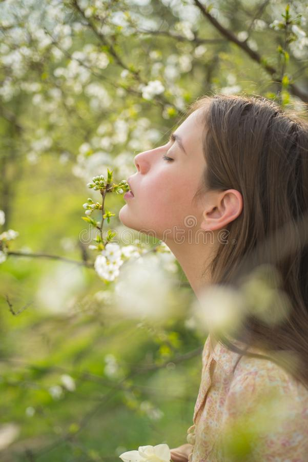Pleasant spring day. Woman with fashion makeup. Summer girl with long hair. face and skincare. Travel in summer. Spring stock photography