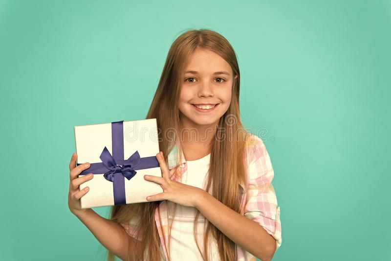 Pleasant surprise. Happy birthday concept. Girl kid hold birthday gift box. Every kid dream about such surprise. Birthday girl carry present. Making gifts stock photo
