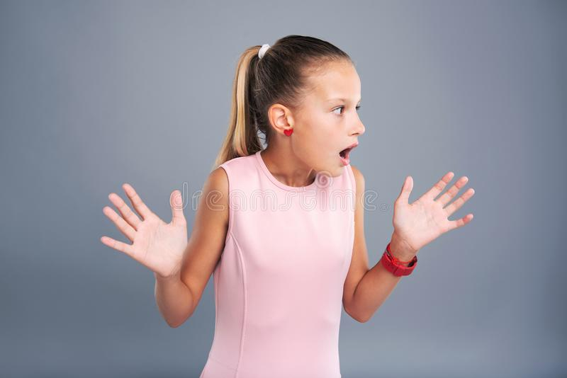 Pleasant teenage girl being scared stock photography