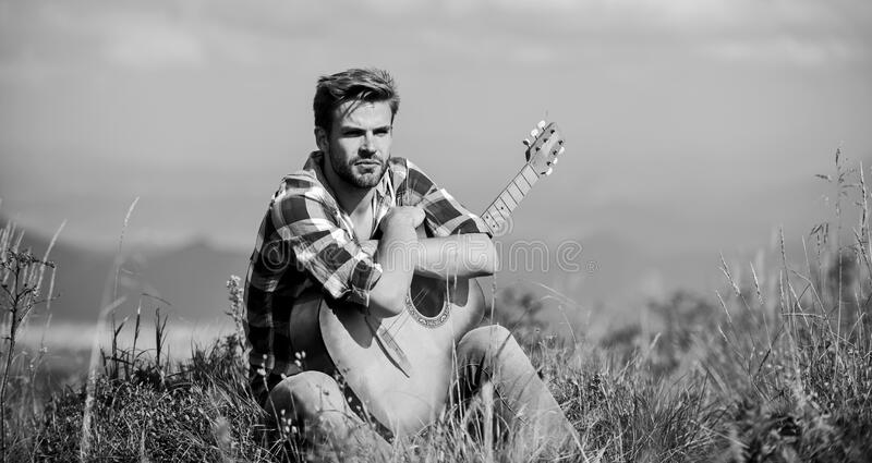 Pleasant time alone. Musician looking for inspiration. Dreamy wanderer. Peaceful mood. Guy with guitar contemplate. Nature. Wanderlust concept. Inspiring nature stock images