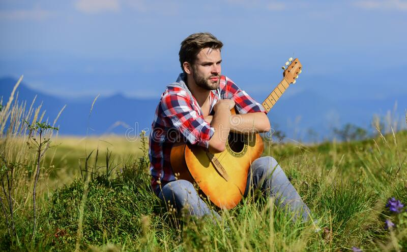 Pleasant time alone. Peaceful mood. Guy with guitar contemplate nature. Wanderlust concept. Inspiring nature. Summer. Vacation highlands nature. Musician royalty free stock photography