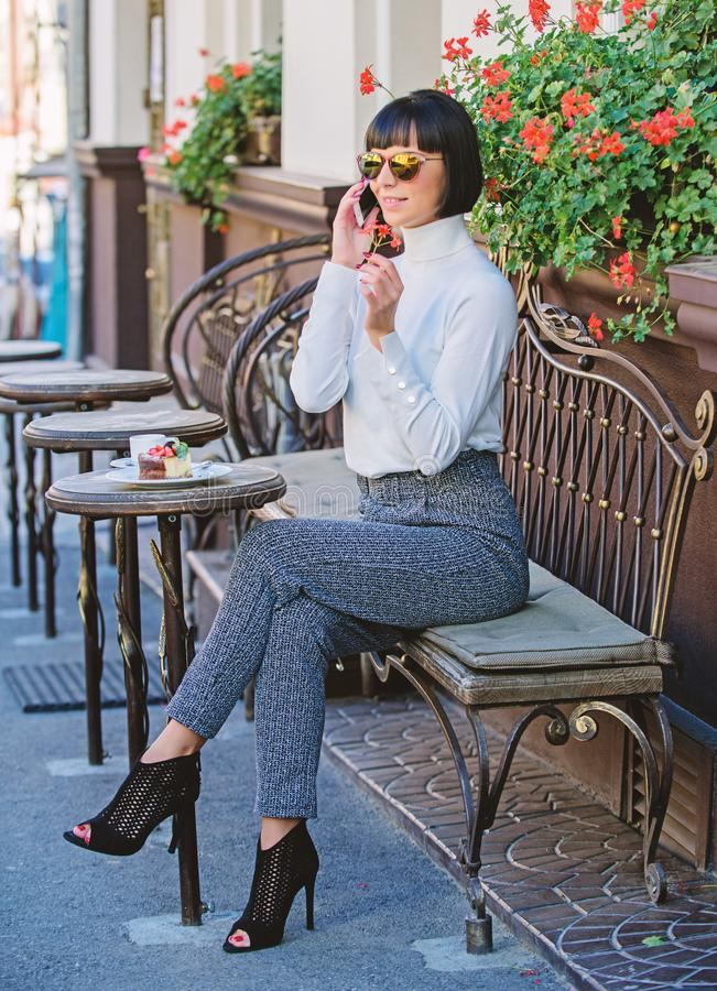 Pleasant time and leisure. Relax and coffee break. Happy to hear you. Woman attractive elegant brunette spend leisure stock photo