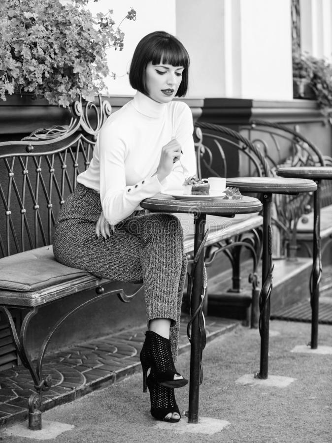 Pleasant time and relaxation. Delicious gourmet cake. Pamper yourself. Girl relax cafe with cake dessert. Woman. Attractive elegant brunette eat gourmet cake royalty free stock photos