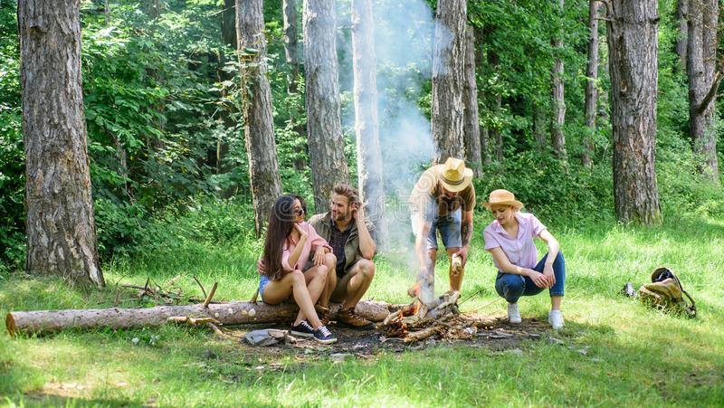 Pleasant weekend near campfire. Company friends relaxing near campfire. Summer vacation. Best friends spend leisure stock photo