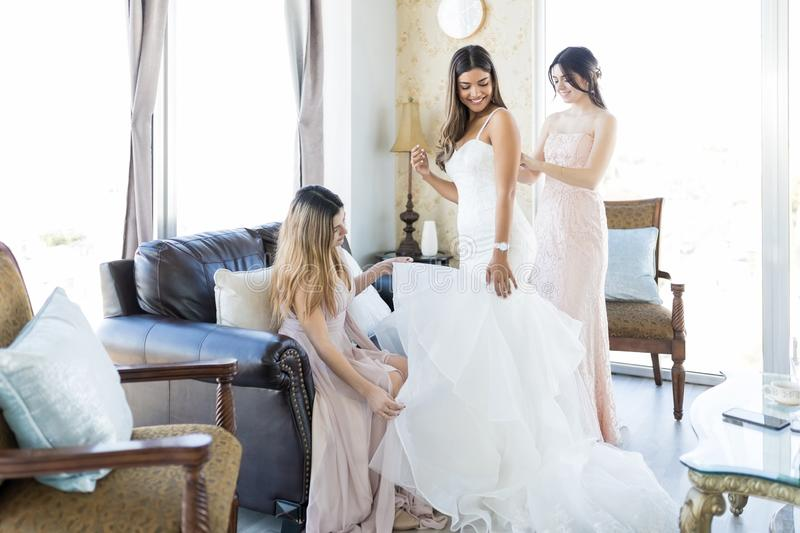 Pleasant Women Helping Friend Getting Ready For Her Marriage stock photo