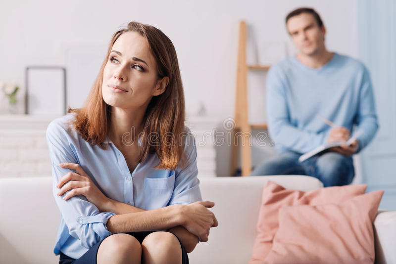 Pleasant young woman consulting with psychologist. royalty free stock images