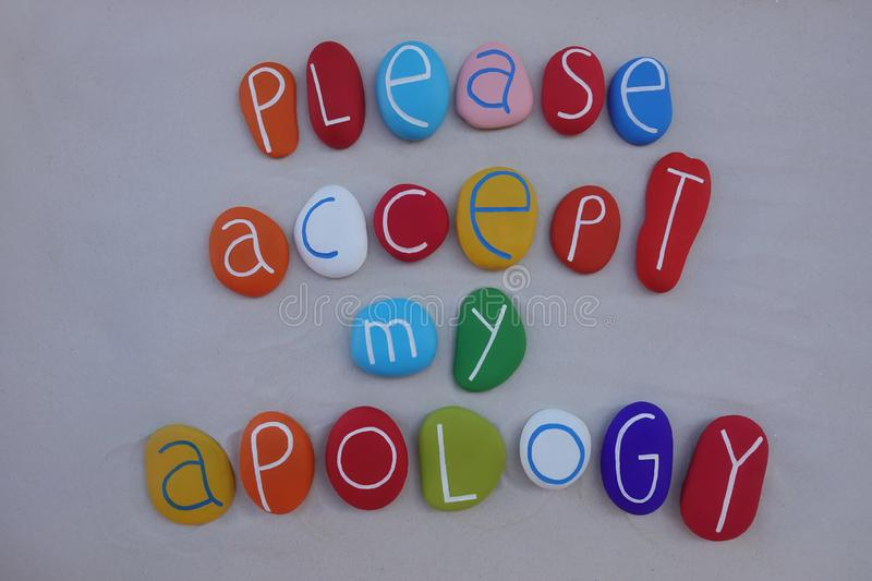 Please, accept my apology. Apology concept composed over white sand with colored and carved sea stones stock photo