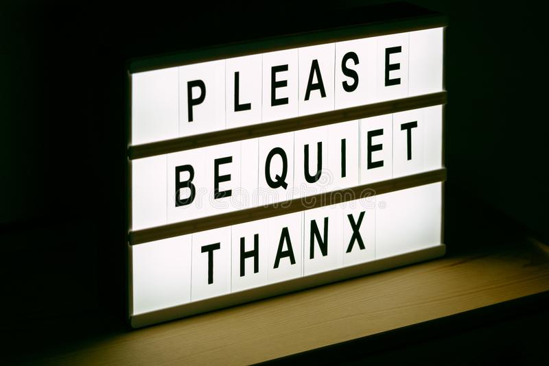 Please be quiet, Thanx message sign. Please be quiet, thanx vintage illuminated message sign in radio or tv studio with live audience royalty free stock images