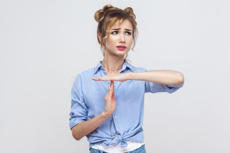 Please break! Time out, stop sign. Young adult blonde girl showing warning sign. stock image