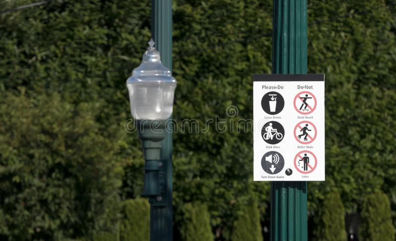 Please do please don't sign next to a street lamp. In daylight royalty free stock photos