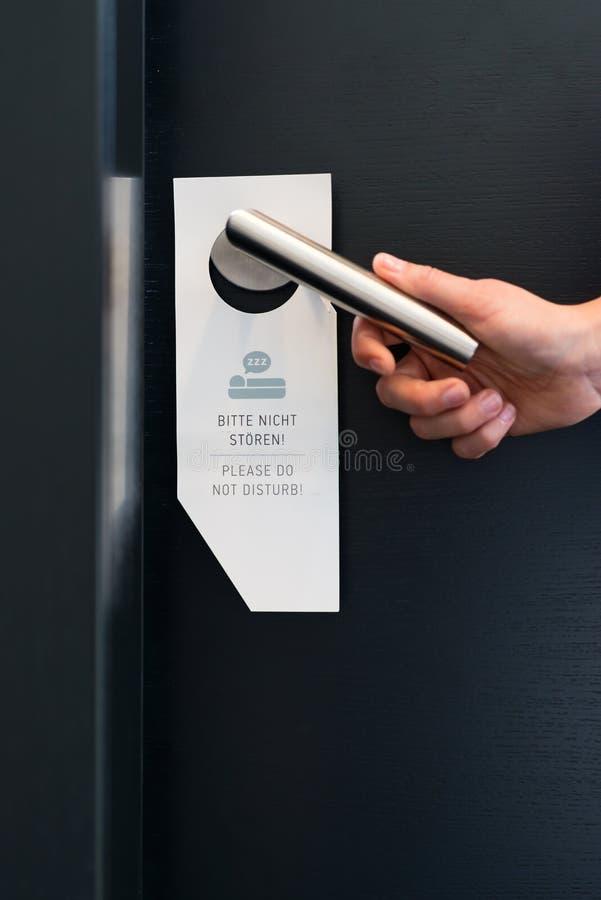 Please do not disturb sign on room door in hotel stock photo