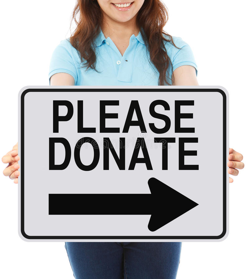 Please Donate. A woman holding a sign indicating Please Donate royalty free stock photo