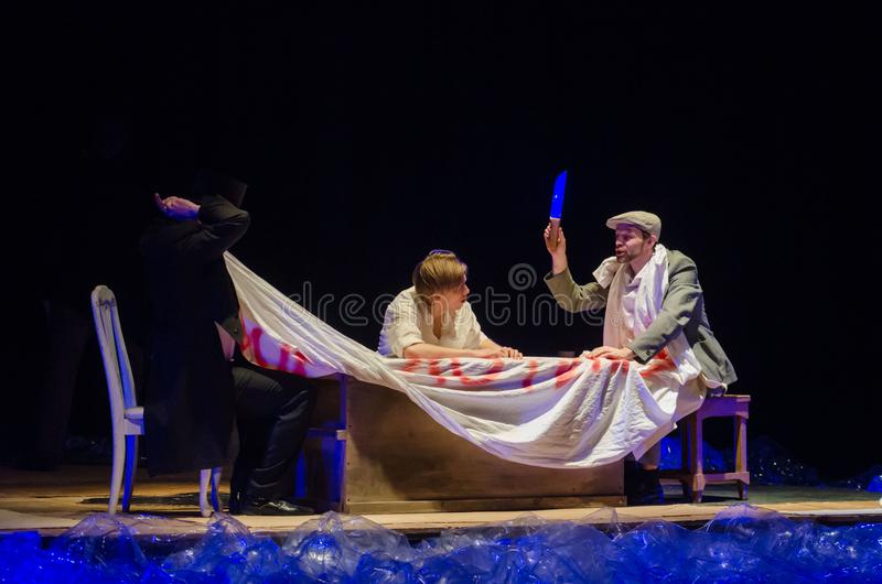 Please, have a drink. DNIPRO, UKRAINE - MARCH 23, 2018: Please, have a drink performed by members of the Dnipro State Drama and Comedy Theatre stock images