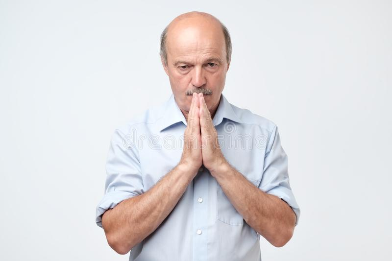 Please help me now. Bald mature man saying need a help stock images