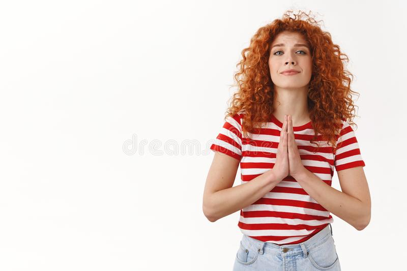 Please I need you. Attractive tender feminine curly redhead woman asking favour press palms pray gesture plead smiling stock photos
