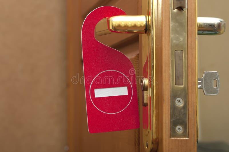 Please störer inte på en dörr arkivfoto