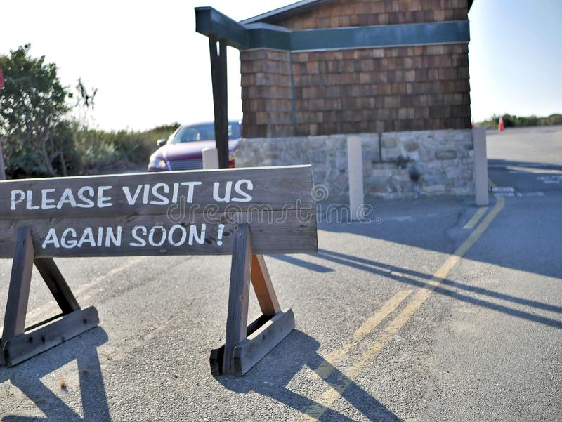 Please visit us again sign shown to visitors leaving nature preserve national park in California. stock photo