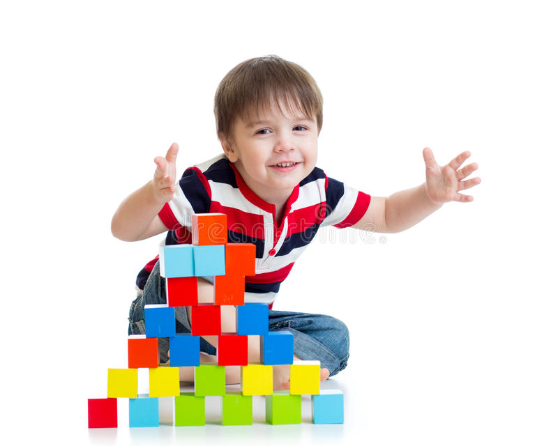 Pleased kid playing toy blocks isolated. Pleased kid boy playing toy blocks isolated stock photos