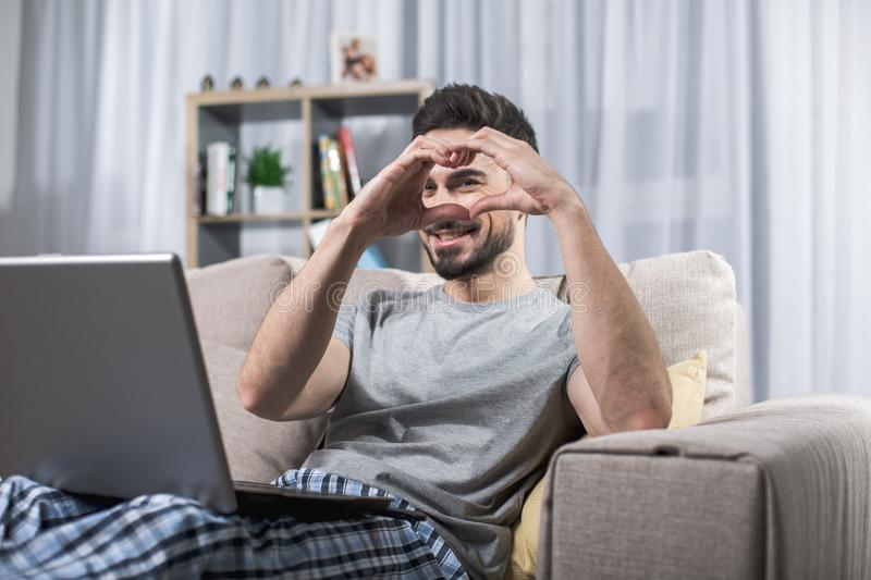 Pleased man enjoying his home pastime royalty free stock images