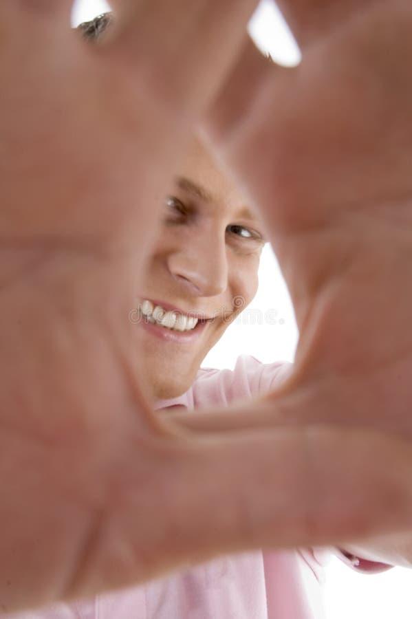 Pleased mens die frame gebaar toont stock afbeelding