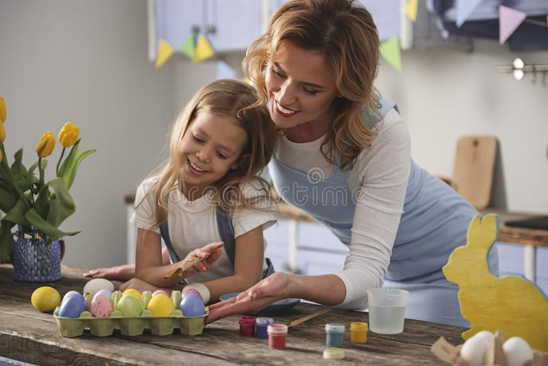 Pleased mother and kid enjoying their creative work royalty free stock photo