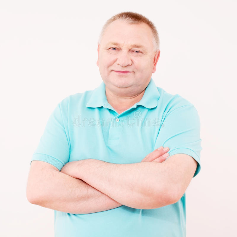 Download Pleased Senior Man In Polo Over White Stock Image - Image of good, mature: 25441383