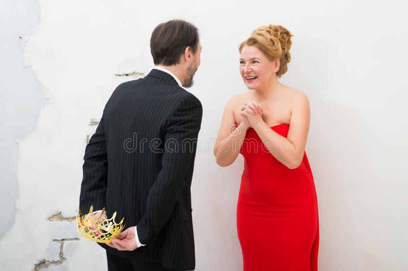 Pleased stylish woman keeping hands together while expecting a present royalty free stock photography