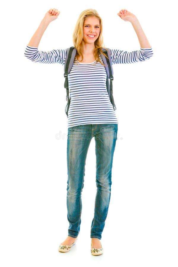 Pleased teengirl with schoolbag enjoying success stock photo