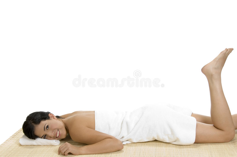 Pleased woman laying on bamboo mat stock images