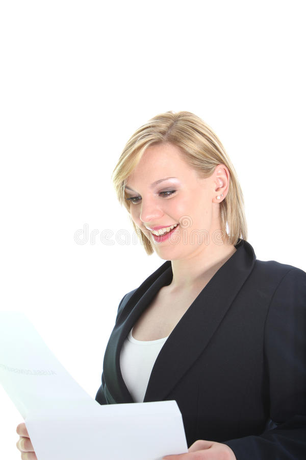 Pleased woman reading a letter stock images
