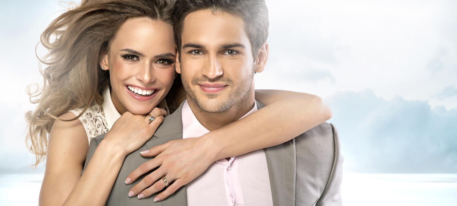 Pleased young guy with his charming girlfriend stock images