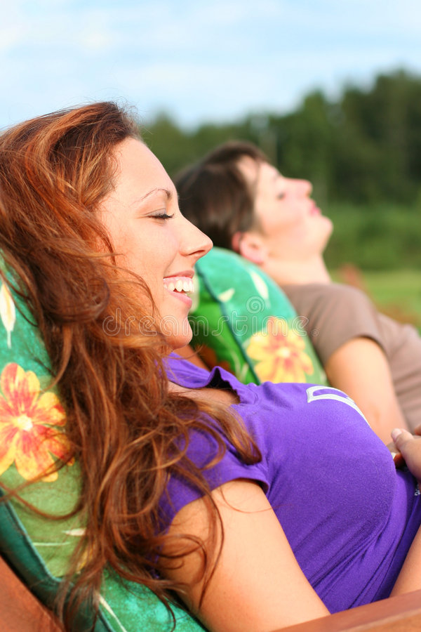 Pleasure. Two young girls relaxing outdoors royalty free stock images